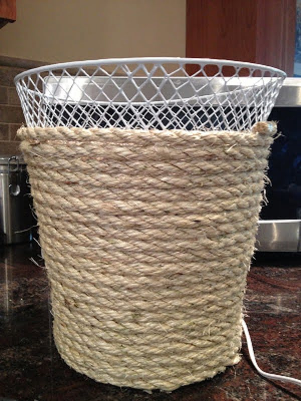 #DIY neat but very easy idea to makeover a plain trashcan with rope for extra decor points. Try it! #homedecorideas