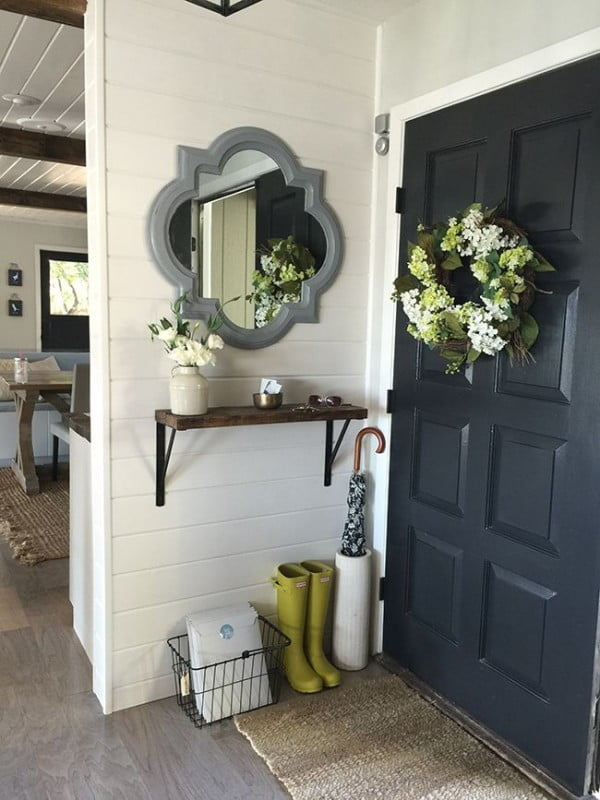 Check out this  entryway decor idea with a storage shelf. Love it!