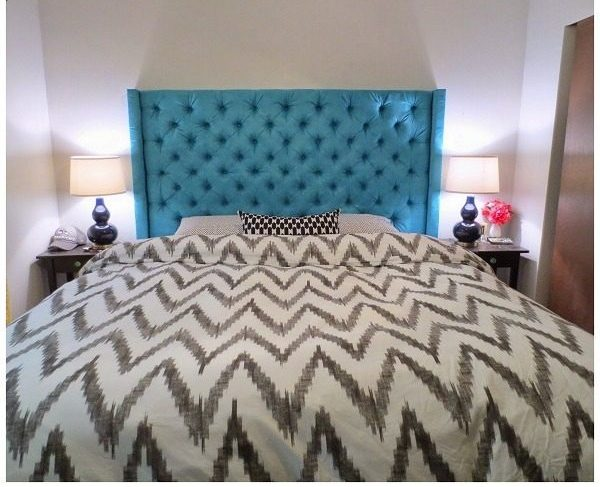 Check out this tutorial on how to make a  deep diamond tufted headboard. Looks easy enough!
