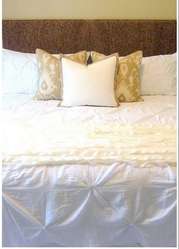 Check out this tutorial on how to make a  rope headboard. Looks easy enough!