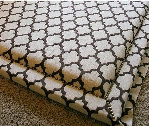 Check out this tutorial on how to make a  upholstered with nail trim headboard. Looks easy enough!