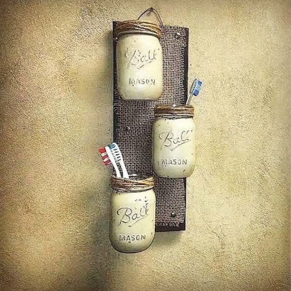 mason jar wall shelves for rustic bathroom decor