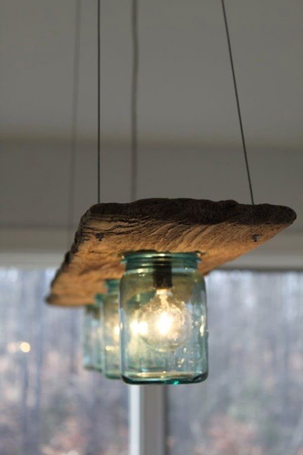 Check out this cool rustic wooden board and mason jar chandelier
