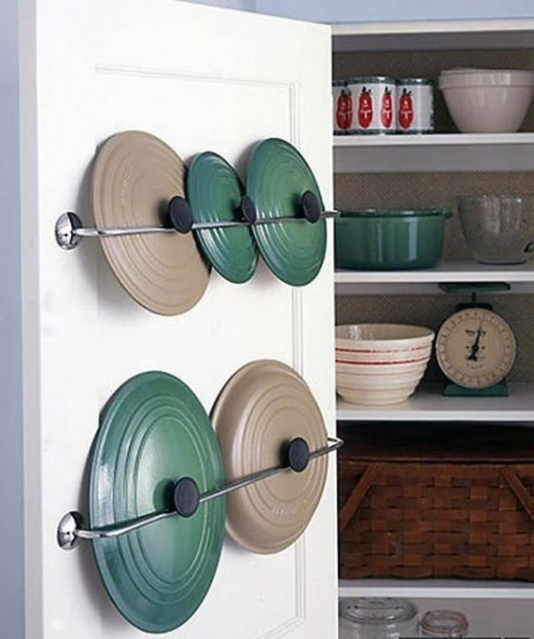 Great idea for lid storage on the inside of cabinet doors