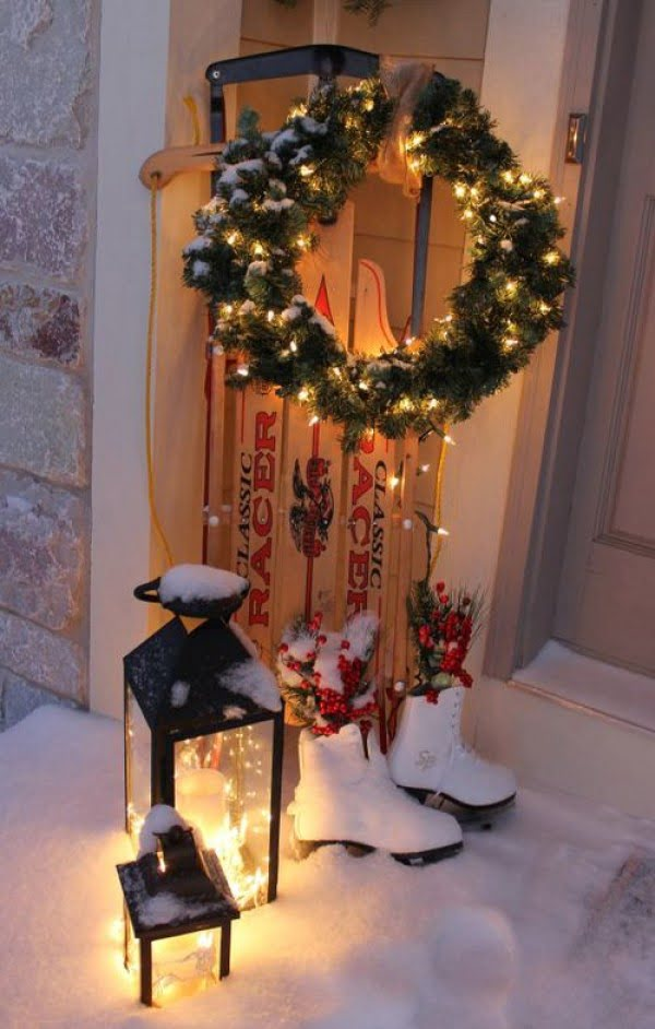 Adorable Christmas front porch decor with sled and skates