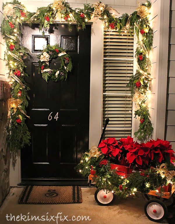 Love the idea for Christmas porch decor with garlands and wagon