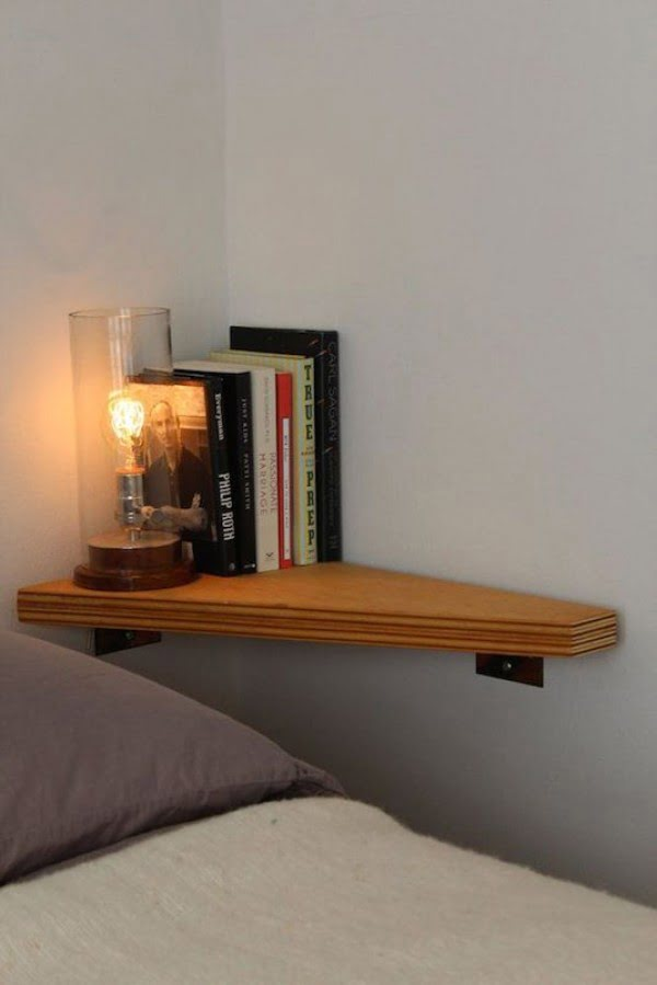 Genius small bedroom nightstand solution with a corner shelf