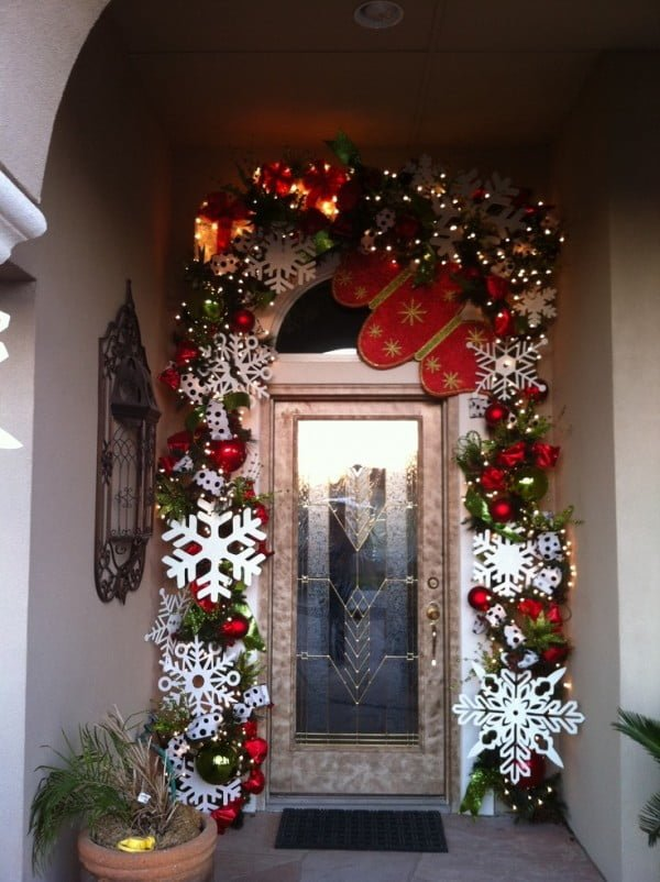 Lovely decorated Christmas porch front door with garlands