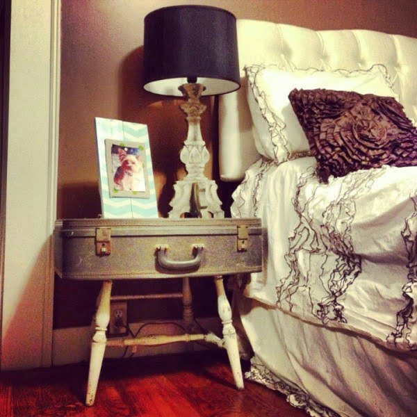 Love the idea of building a DIY nightstand from an old suitcase