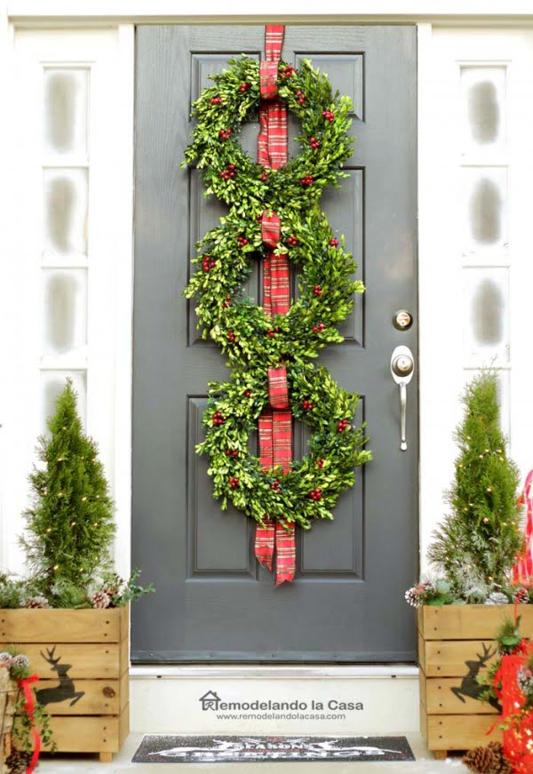 Beautiful front porch Christmas decor with Christmas wreaths and rustic boxes