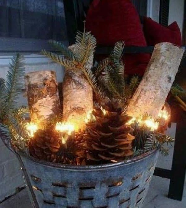 Simple but adorable rustic Christmas porch decor idea with a galvanized bucket and firewood