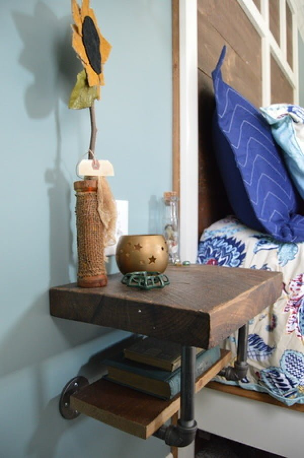 Love the industrial style pipe shelf nightstand