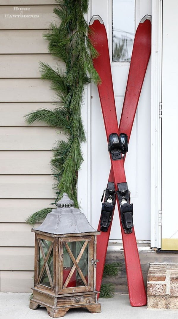 Chalk painted skis for front porch Christmas decor