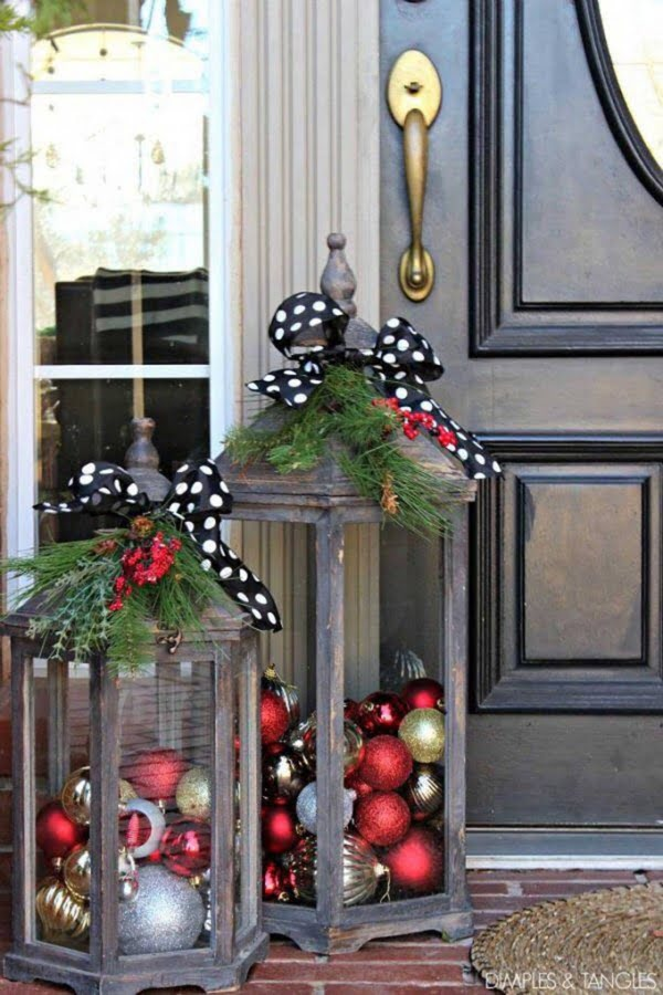 Love the idea for front porch Christmas decor with rustic lanterns