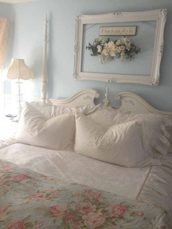 Beautiful shabby chic wall decor with a picture frame and flowers