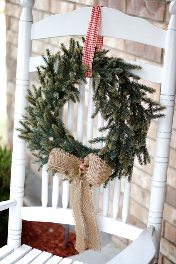 Beautiful Christmas porch decor idea with a vintage chair