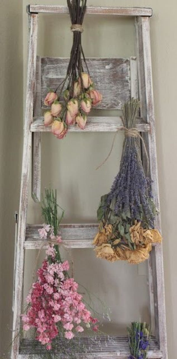Lovely idea of a shabby chic ladder and floral decor for bedroom