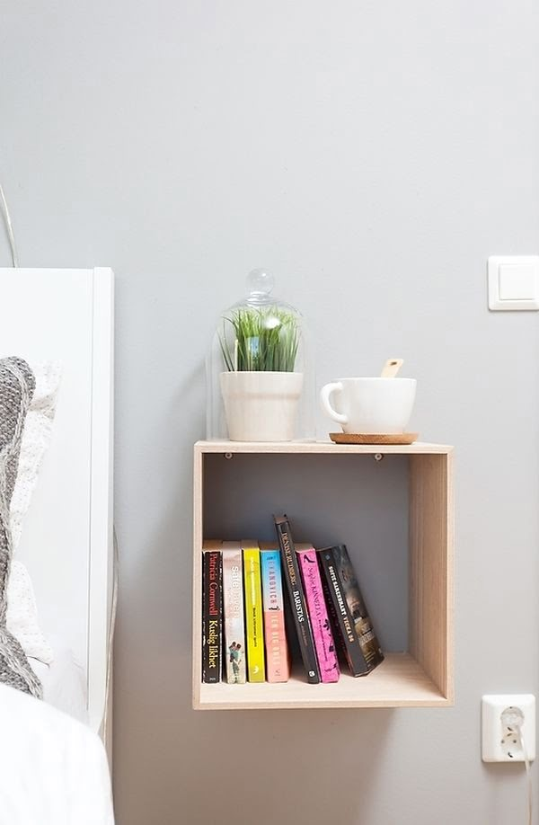 Lovely floating box shelf nightstand in a small bedroom
