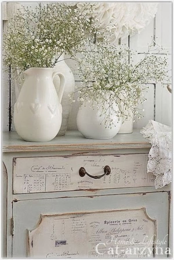 Lovely shabby chic bedroom decor with vintage dresser and fresh flowers