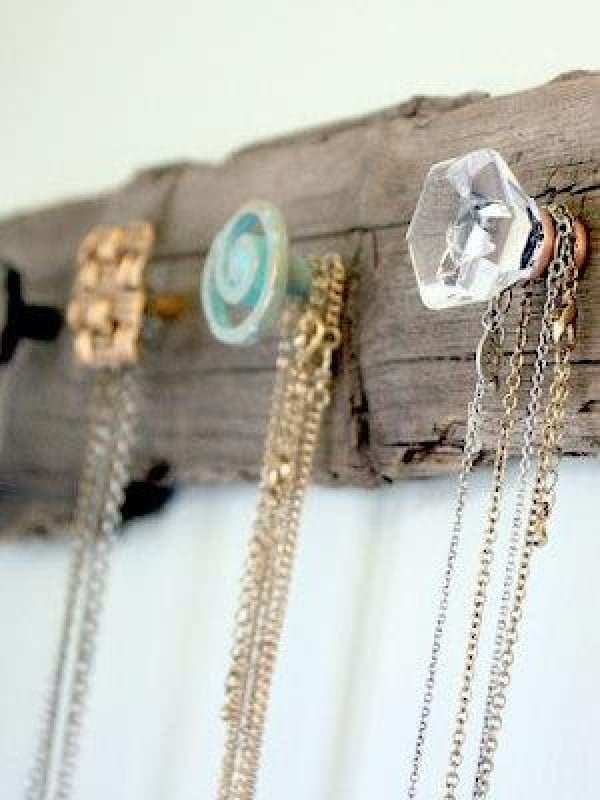 Love the shabby chic coat rack made of driftwood and crystal knobs