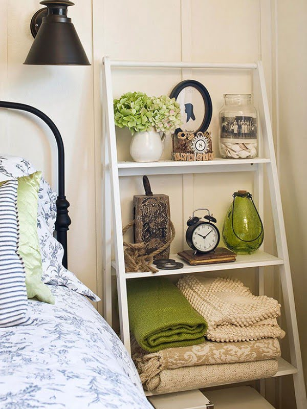 Nice idea to use a ladder shelf as a nightstand for more storage in a small bedroom