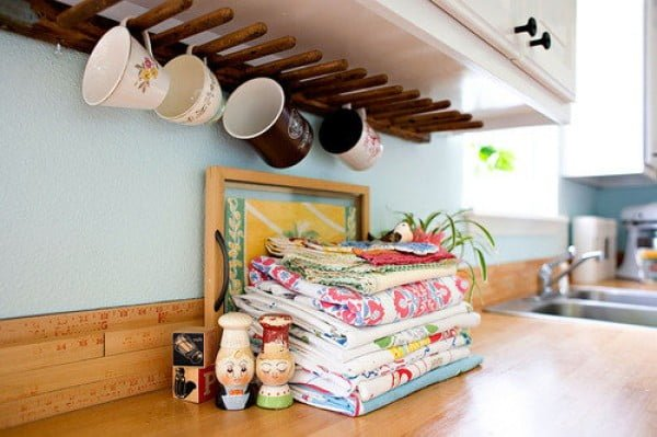 13 Brilliant DIY Mug Racks You'll Have Fun Making - Love the idea for a DIY coffee mug rack under the cabinet