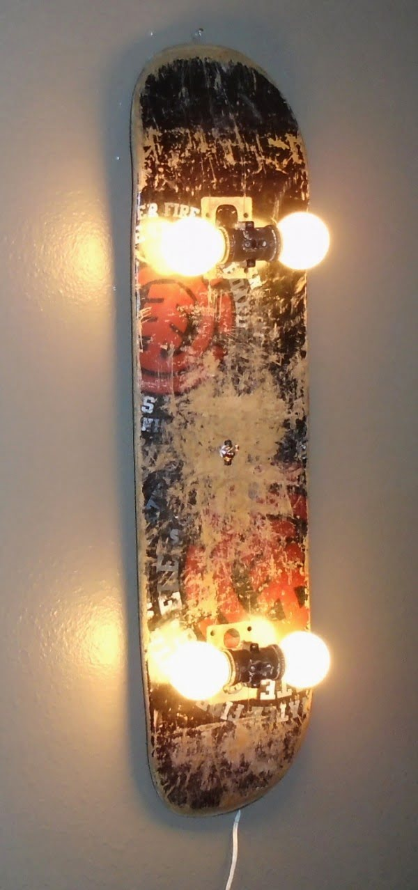 Check out this cool wall lamp made of an old skateboard