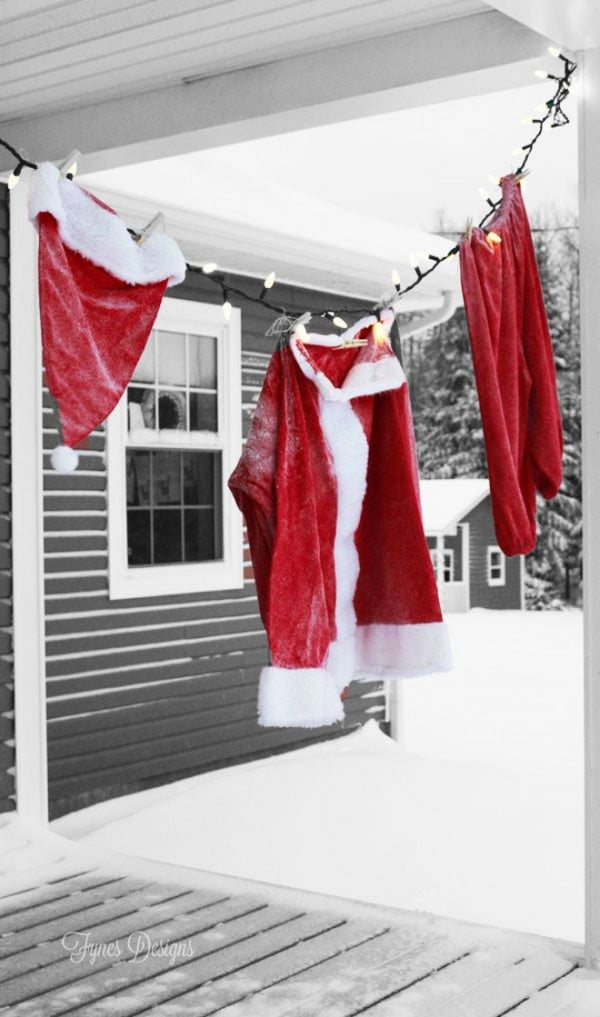 Cute idea for Christmas porch decor with Santa's clothes
