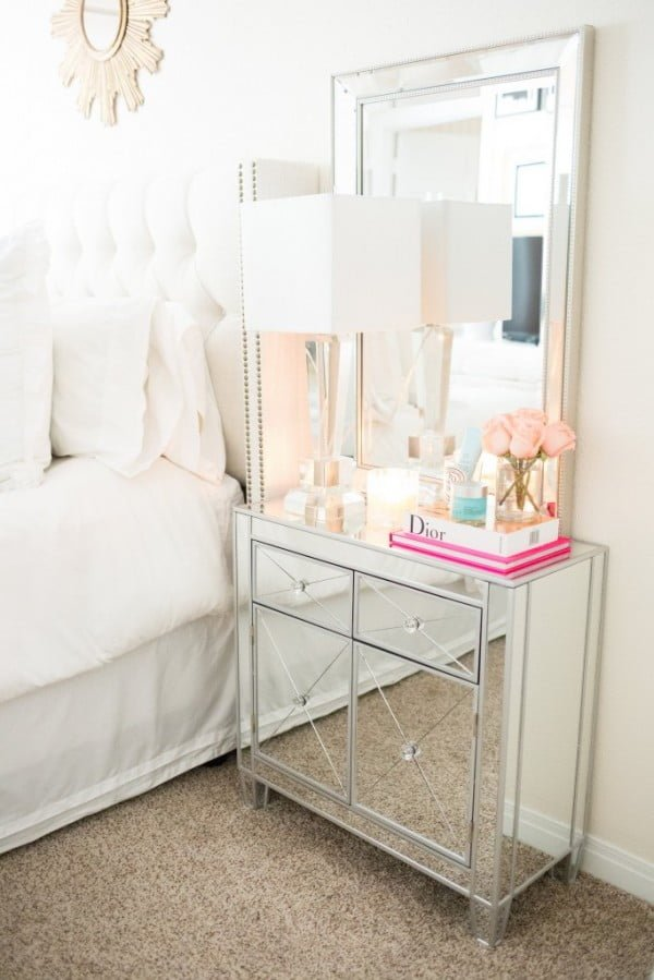 Love the gorgeous mirror nightstand. So glamorous!