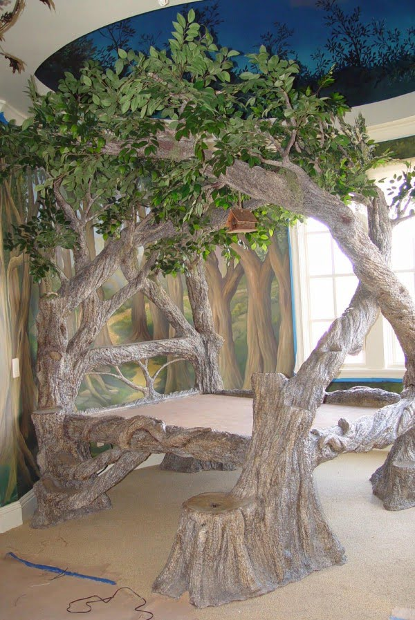 Truly enchanting bed frame from tree trunks with branches
