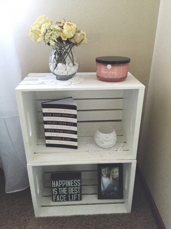 Love the rustic nightstand made of crates