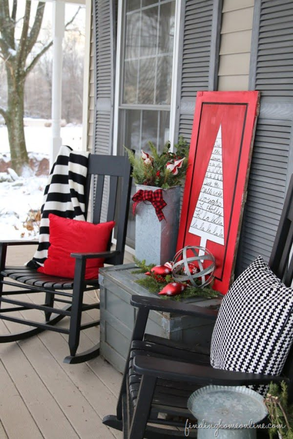 Love the idea for Christmas porch decor with festive wooden sign