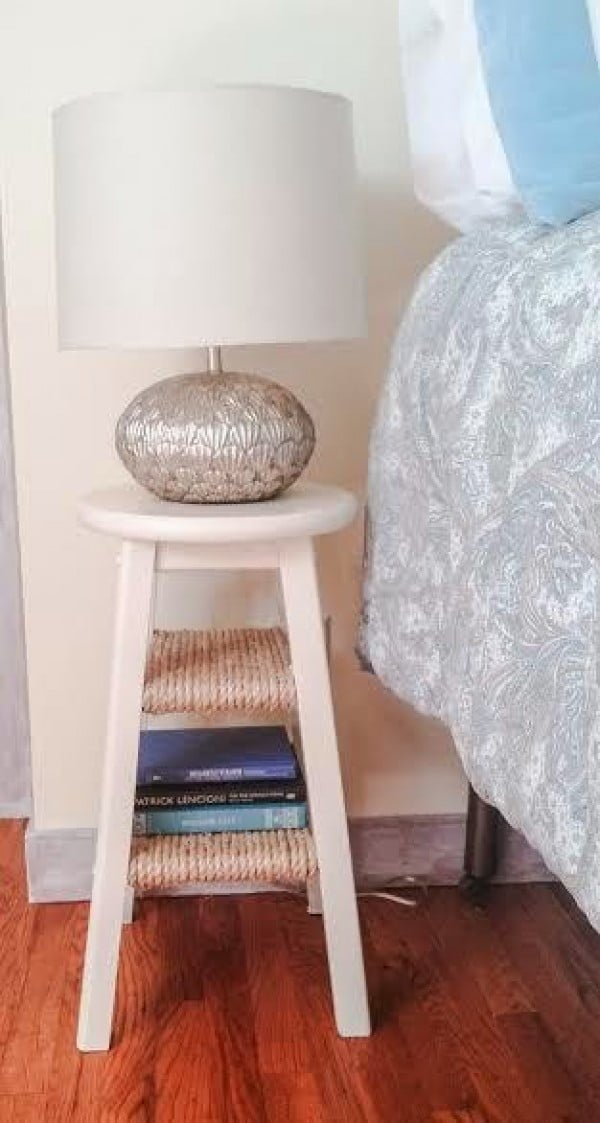 Awesome use of an old stool for a unique nightstand