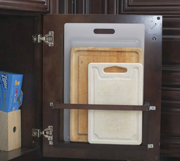 Great idea for cutting board storage holder on the inside of cabinet doors