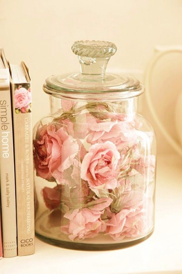 Lovely shabby chic decor vignette with floral jar