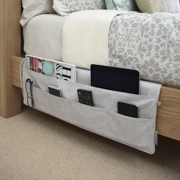 Love these bed pockets for extra storage in the bedroom