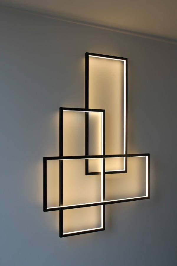 Check out this cool triple frame wall sconce lamp