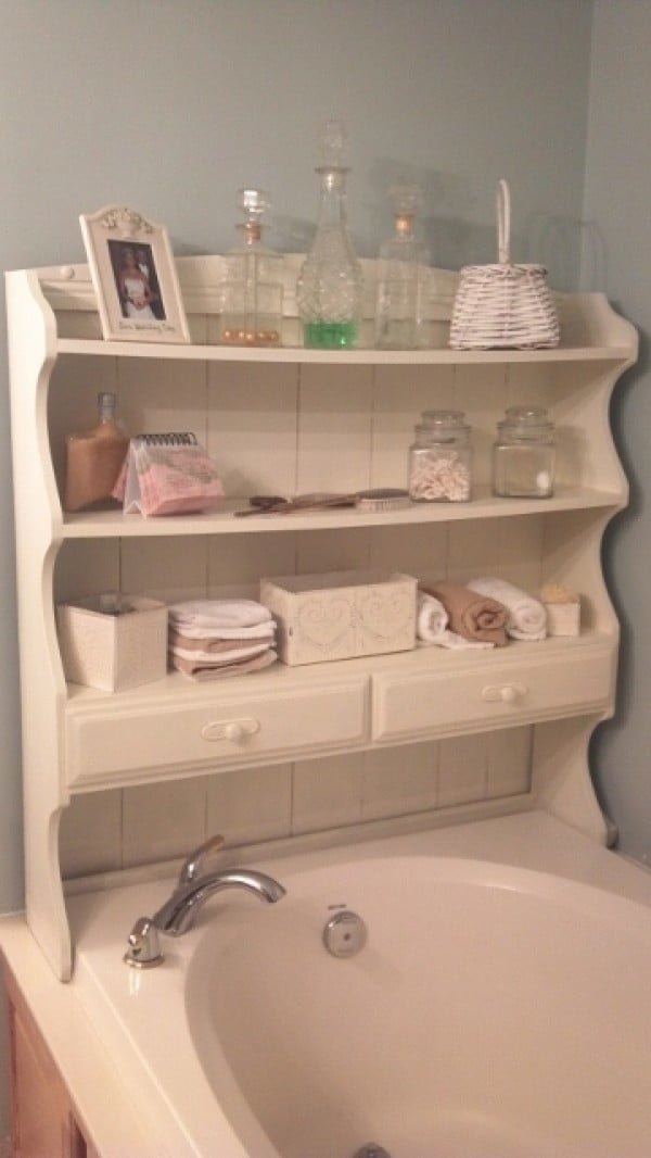 Love the small bathroom storage solution with over the bathtub cabinet