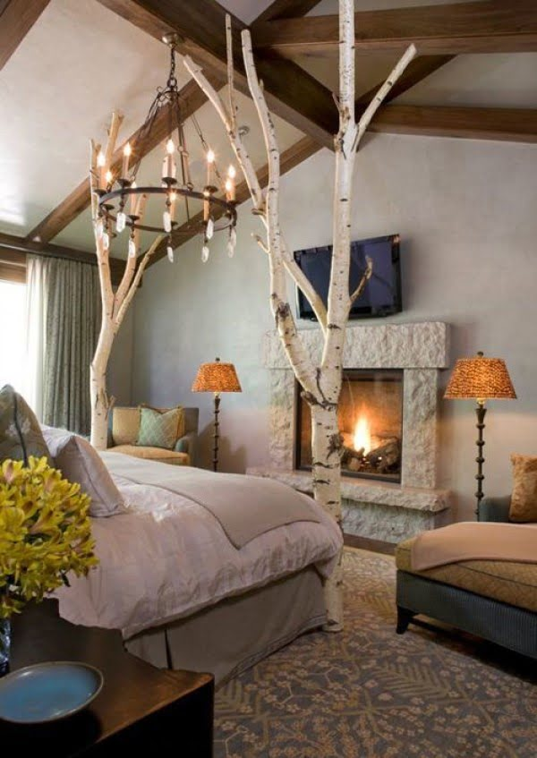 Love the idea of birch tree trunks used as bed end posts. Great rustic design