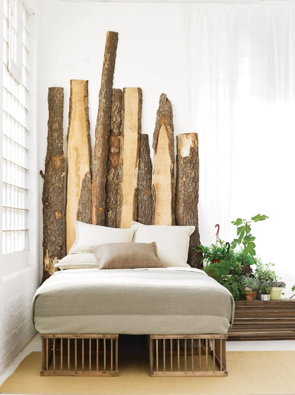 Love the headboard made of cut tree trunks
