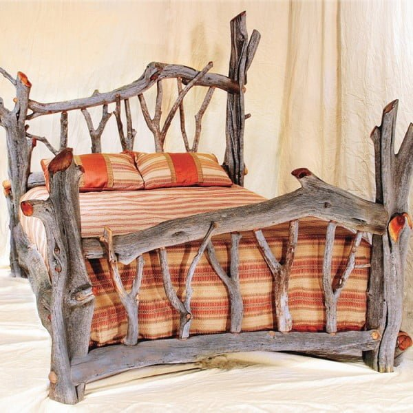 Love the bed frame made of driftwood and its rustic appeal
