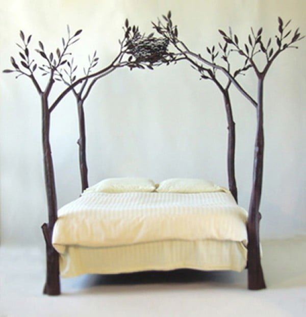 Adorable bed frame design with tree branches and a birds nest