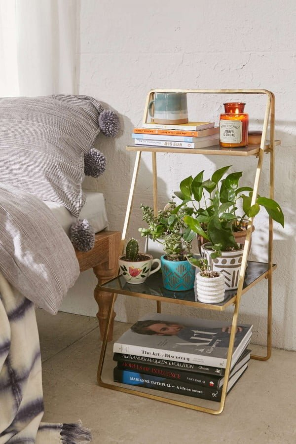 Love the brass ladder shelf rack as a nightstand