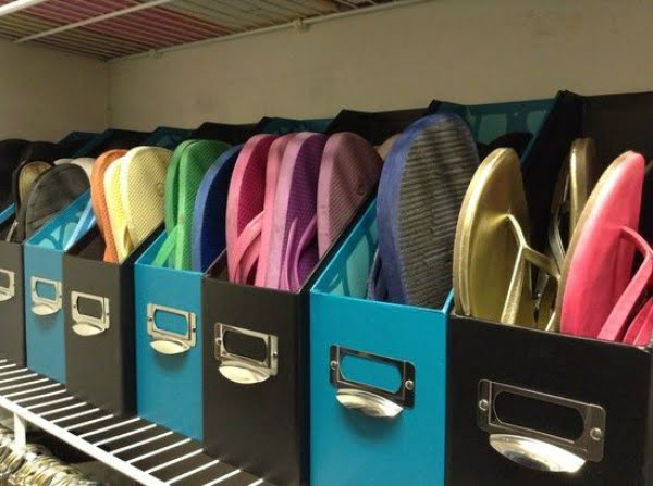 Brilliant idea to store slippers in magazine holders