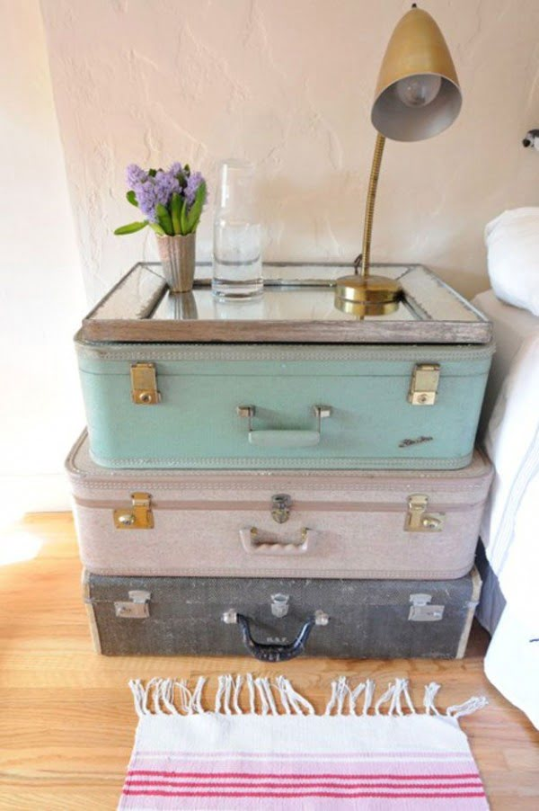 Love the idea of a shabby chic nightstand made of old suitcases