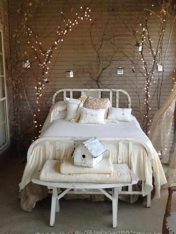 Love the idea of tree branches and fairy lights for shabby chic bedroom decor