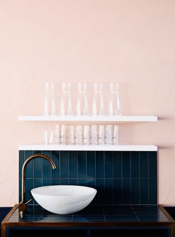Love the navy blue bathroom counter with marble sink