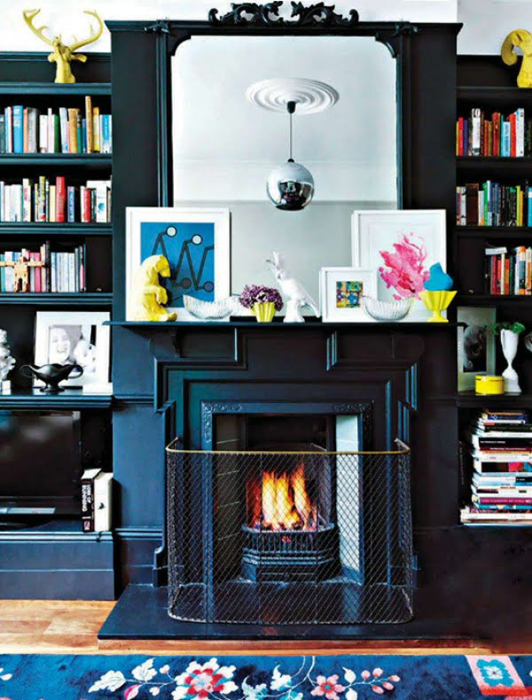 Love the navy blue cabinets and fireplace - a very sophisticated look