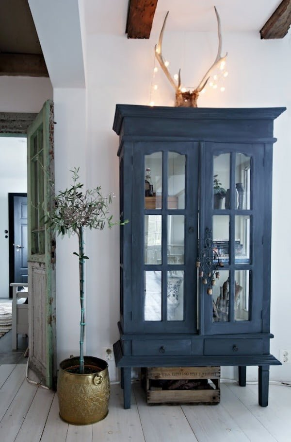Love the navy blue cabinet contrasting against the white walls
