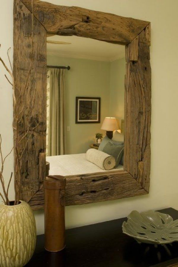 Love this rustic reclaimed wood mirror frame